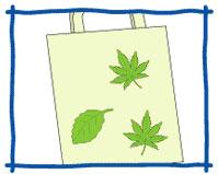 エコバックなどの無地のものに葉っぱを貼付け、しっかりとおさえます。